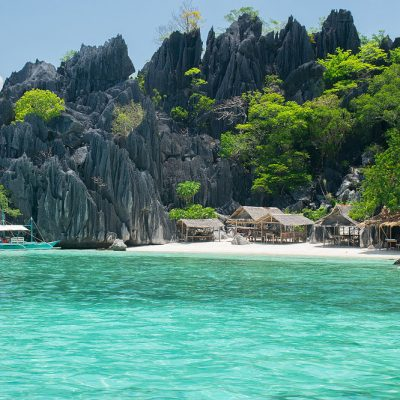 Small beach with few cabins and clear water of the Phillipines