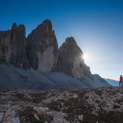 The sun passing behind Tre Cime di Lavaredo
