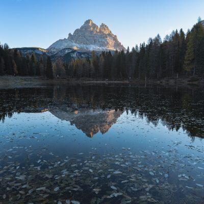 Tre Cime di Lavaredo reflecting in Antorno Lake in Dolomites