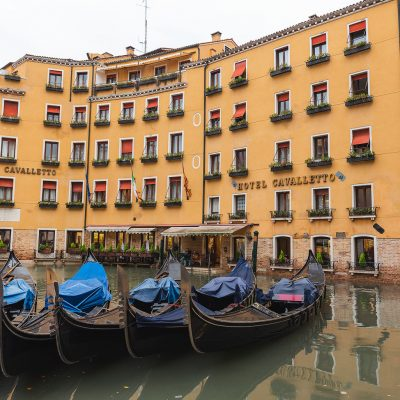 Gondolas parked in front of an hotel in Venezia
