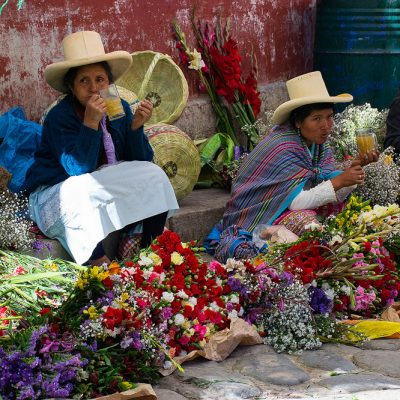 Peruvian women selling flowers at the local market