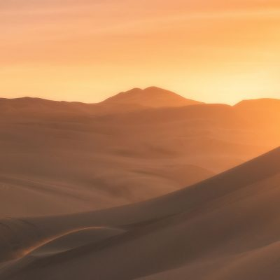 Sunset over Huacachina desert in Peru