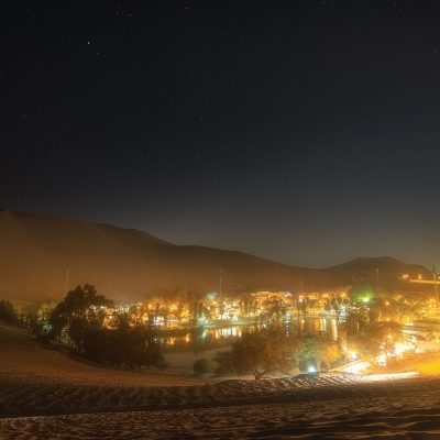 Huacachina village by night in the desert of Peru