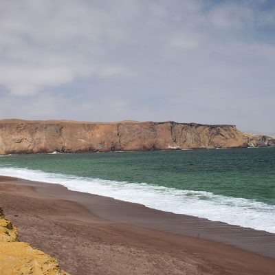 The famous red sand beach of Paracas in Peru