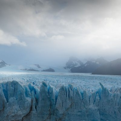 Sun litting up a part of Perito Moreno Glacier during a cloudy Fall day
