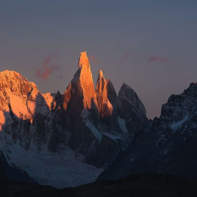 Cerro Torre lit up by first ray of sun during sunrise