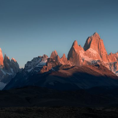 Panoramic view of Cerro Torre and Fitz Roy mountain ranges at sunrise
