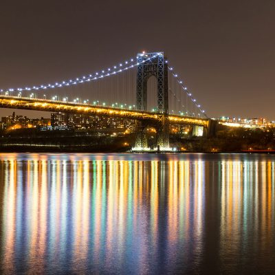 George Washington Bridge at night with a perfect reflection in Hudson River
