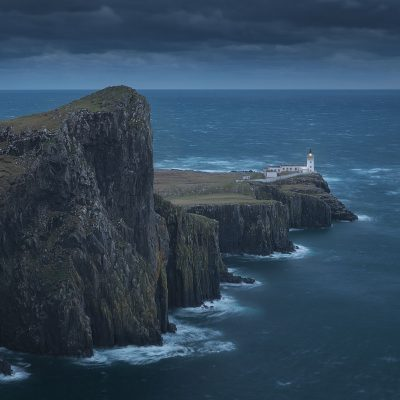 Nest Point lighthouse is the westernmost point of Isle of Skye, during a moody fall sunset