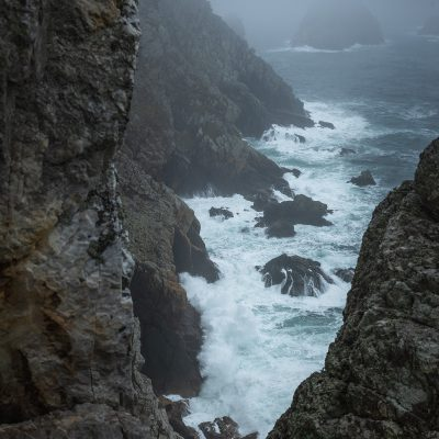 Strong waves hitting the costline of Bretagne during a moody day