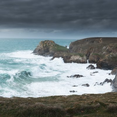 Strong wave hitting the shoreline of Bretagne on a moody afternoon